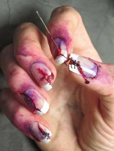 Zombie Halloween Nails. This is disgusting and amazing at the same time!