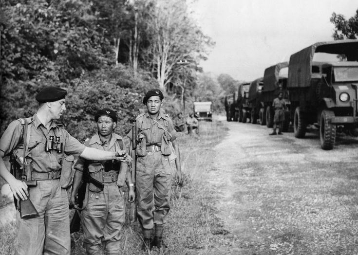 Captain E. Gopsill of the 7th Gurkha Rifles gives final instructions to the platoon leaders before taking them into the jungle near Kuala Lumpur for insurgents sweep on July 10, 1948.(AP Photo)