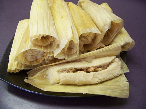 Chicken tamales from Mexico. The tamale is a traditional Mexican dish made by filling a masa coated leaf with any number of ingredients and then cooked by steam. This is good.