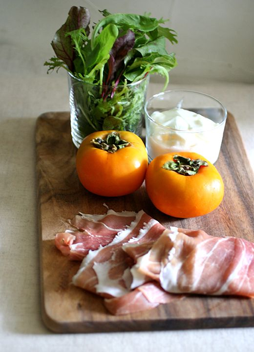 Persimmon and Prosciutto salad // 2 Persimmons; 4 pieces Prosciutto & salad leaves // dressing:* 100 g plain yogurt; 1 Tsp olive oil; 1 Tsp apple cider vinegar;  1/2 tsp salt; pepper