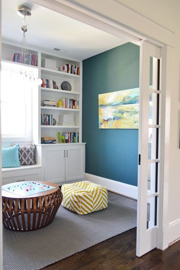 The Show Must Go On | Young House Love {pocket doors, built-ins, bold color}