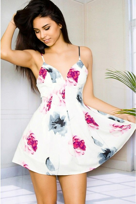 Tease your first date in this flirty floral skater summer dress.