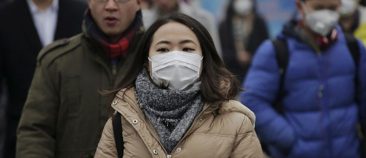 """The Global Risks Landscape 2018       : Morning commuters wear protective masks to shield from extreme smog in central Beijing December 8, 2015 as China's capital issues its first ever """"red alert"""" for pollution. REUTERS/Damir Sagolj - GF10000258169"""