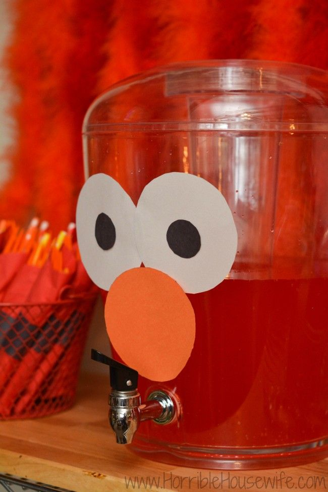 Elmo birthday party ideas- add construction paper eyes and nose to a dispenser full of red punch