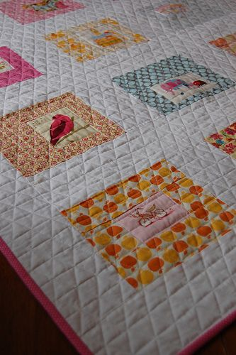 Triangle machine quilting quilt. Pink, oranges,