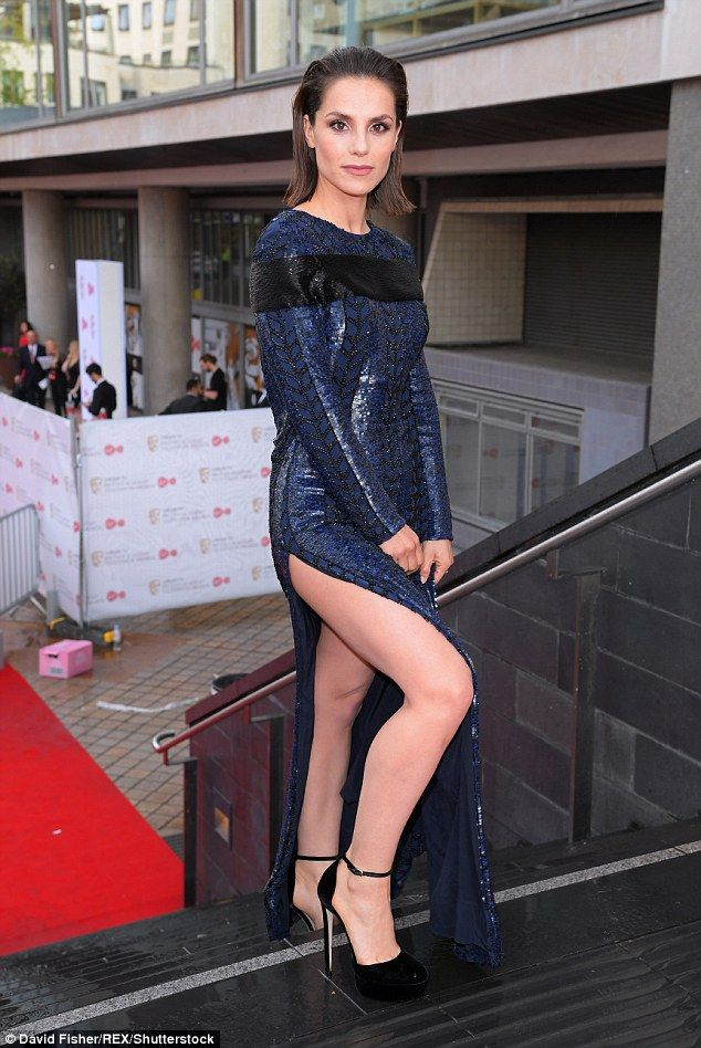 Charlotte Riley shows off her toned legs in a revealing slit dress #dailymail