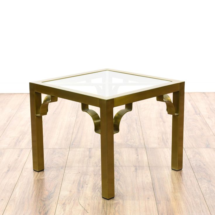 This modern regency end table is featured in a durable metal with a shiny brushed brass finish. This contemporary side table has curved corners, square glass table tops and straight legs. Perfect for holding drinks and snacks next to a sofa! #contemporary #tables #endtable #sandiegovintage #vintagefurniture