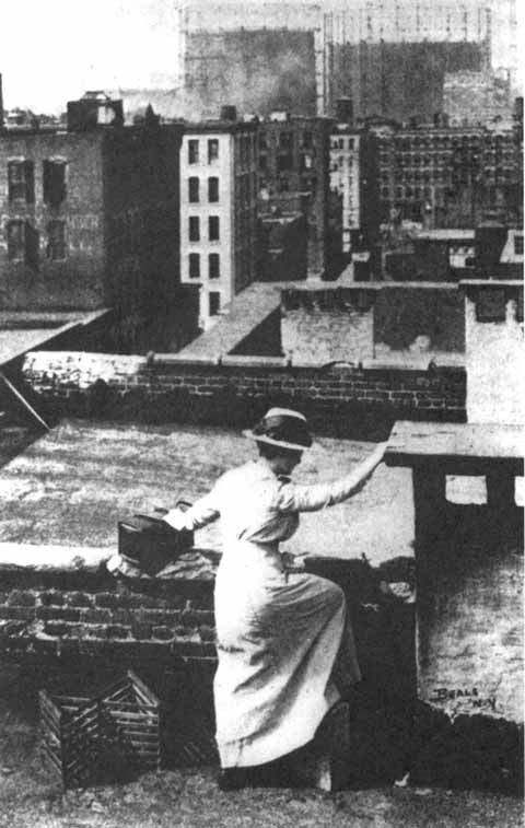 Henry Street Settlement visiting nurse, using rooftops to go from house to house to save climbing up and down stairs.