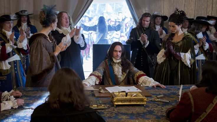 Season 1 of The hit Canal+ series Versailles - King Louis XIV & in the background Monsieur Philippe Duc D'Orleans