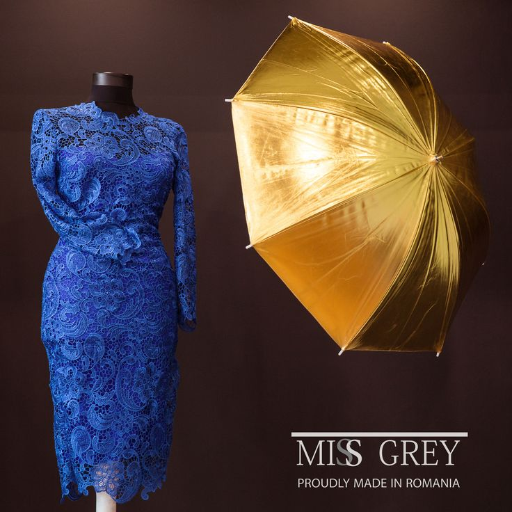 Blue lace midi dress with subtle V cut on the back.