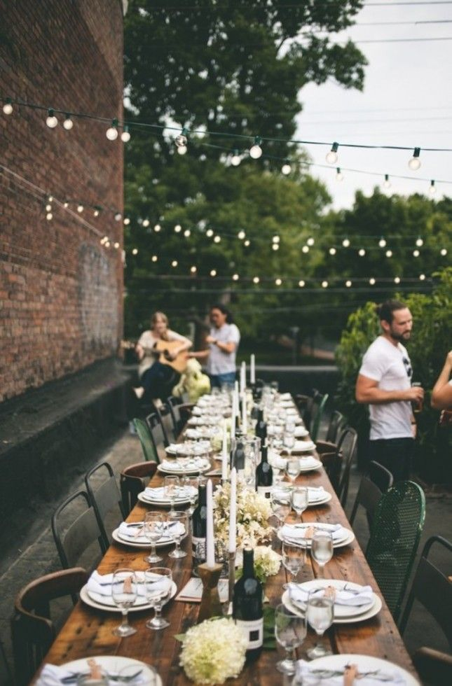 A rooftop dinner is the perfect place to host your rehearsal dinner. #WeddingPlanning