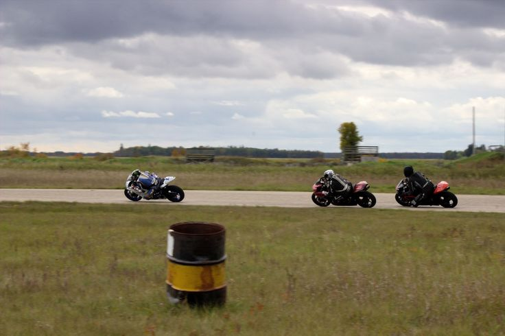 3 motorcyles racing through turn 5 at GMP '14