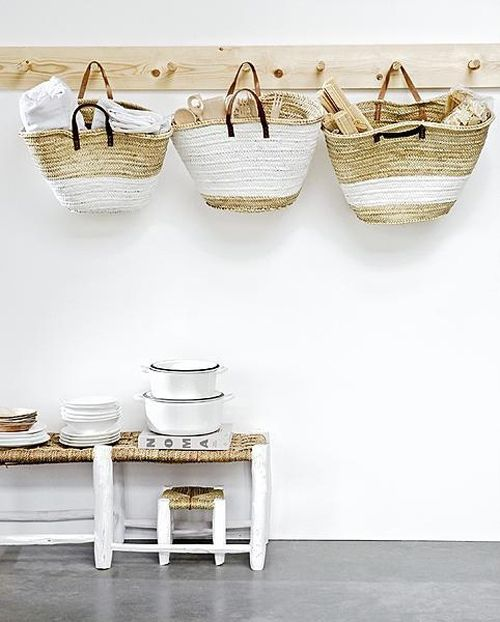 Moroccan style market baskets and stools make perfect sense by the sea. DIY project?