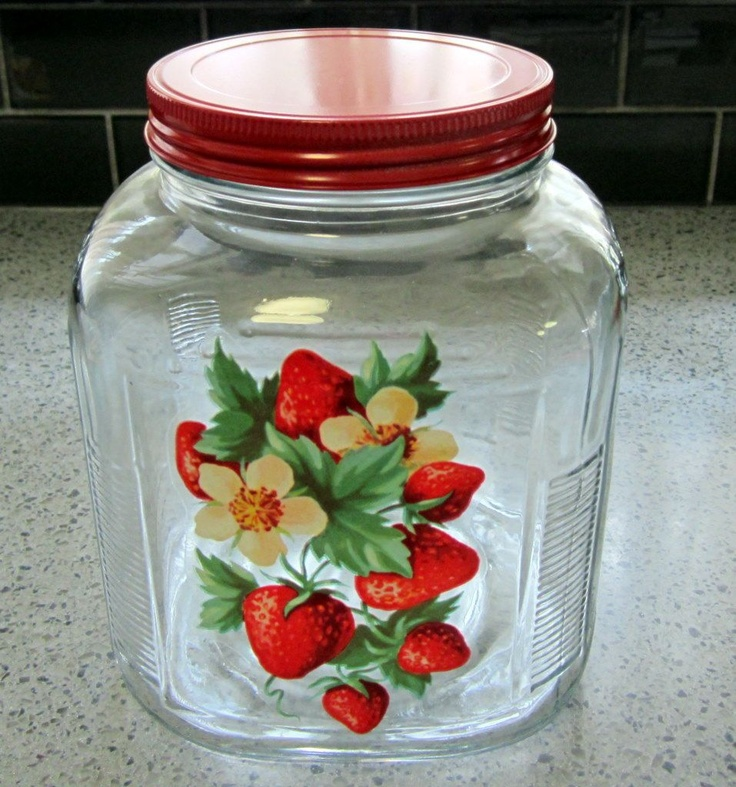 .old kitchen storage jar with strawberry decal & red lid