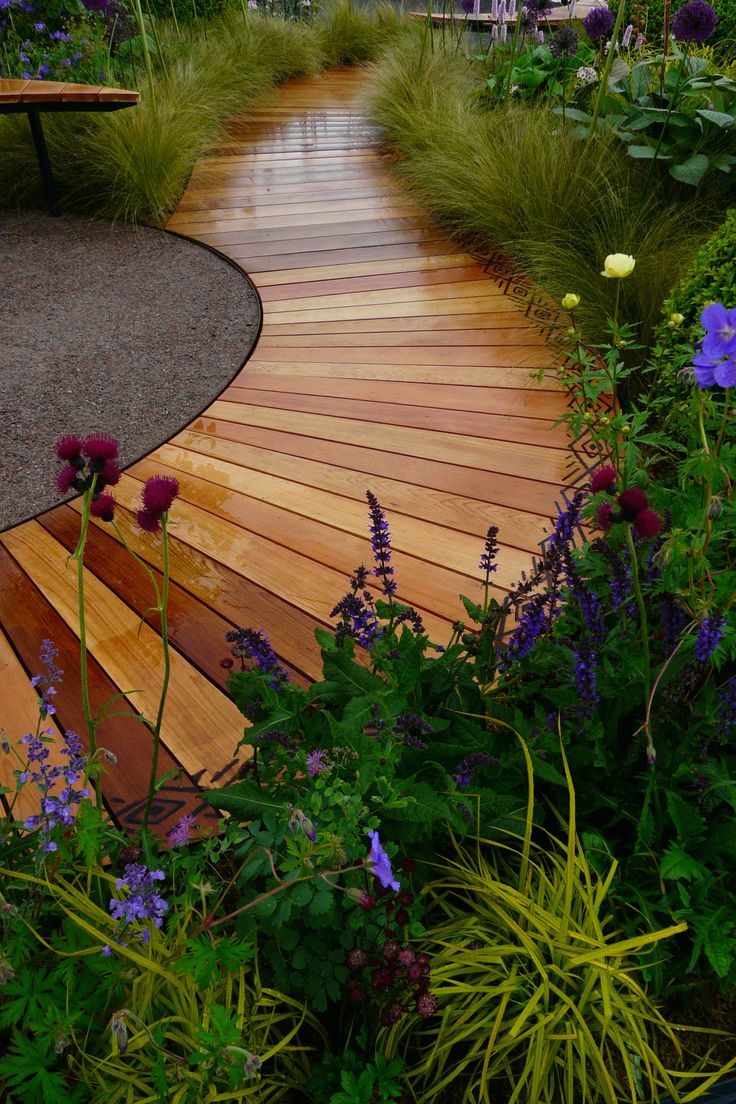 Designed by Carolyn Grohmann. Curving cedar boardwalk with scorched edging built by Kevin Clark.
