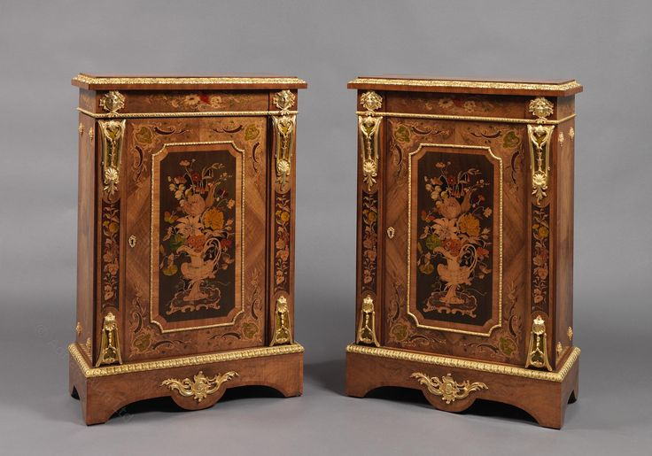 A Fine Pair of Gilt-Bronze Mounted and Marquetry Inlaid Walnut Pier Cabinets  English, Circa 1870.