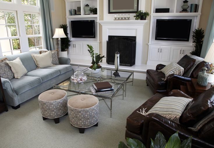 Living room with built-in white shelves flanking the white fireplace.