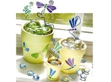 Brighten a windowsill with these charming stenciled dragonfly and butterfly clay pots!