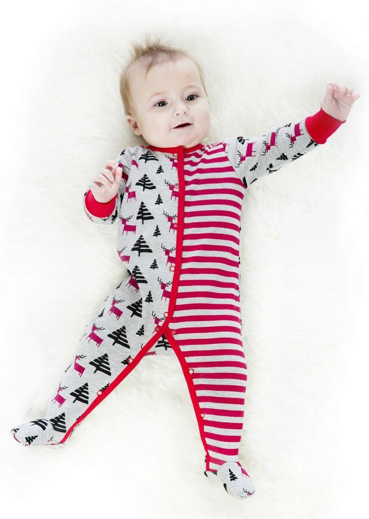Reindeer, fir trees, and stripes combine in contrasting whimsy to create the oh-so-comfortable One-Piece Holiday Pyjama. This one-piece holiday pajama is made from 100% cotton and features a super soft design with long sleeves, solid elastic cuffs and solid trim, a snap front placket, and snap legs for easy diaper changes.