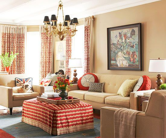 Wake up a monochromatic neutral palette with pops of a rich, warm color. Look for accent colors that are saturated, but have brown undertones to keep the look cozy. In this living room, rustic apple red appears in fabric and accessories and follows one of the key rules for decorating with accent colors: Repeat an accent at least three times in a space to make it stick./