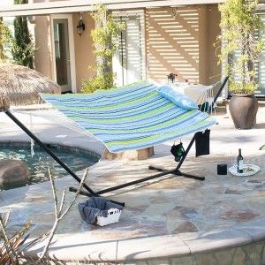 This hammock includes hardwood spreader bars on opposite ends, which attach to a powder-coated steel stand. Setting up is a breeze with the tool-free lock-pin assembly system. S-hooks and chains provide a secure hold for up to two people!