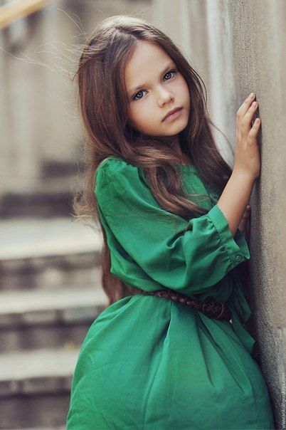On location, 2/3 pose with wall, nice stairs in the background, child model