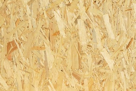 Have you heard of OSB? It is short for oriented strand board, a type of building material made of strands of smaller logs. It is a different sort of wood from both plywood and chipboard in that it is made by combining the three layers wood strands and resin, put together at 90 degree alternates.