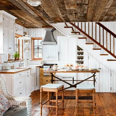 coastal cottage kitchen with wood plank walls, vintage-style details, built-ins and wood floors