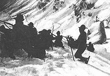 Alpini in posizione di tiro sull'Adamello.