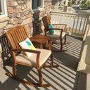 Enjoy the outdoors with this rustic set of two rocking chairs and one side table. The Coyne rocking set will be the perfect piece for you patio, backyard, porch, or deck. Replace and stay comfortable with the polyester seat cushion as you rock back and forth to the wind or to your own beat.
