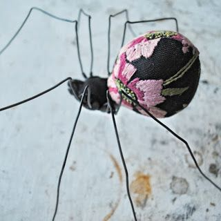Spider: Textile Art.  Mister Finch. He likes to use old tapestries--look how he has cut the fabric just so, placed the stitches just so....