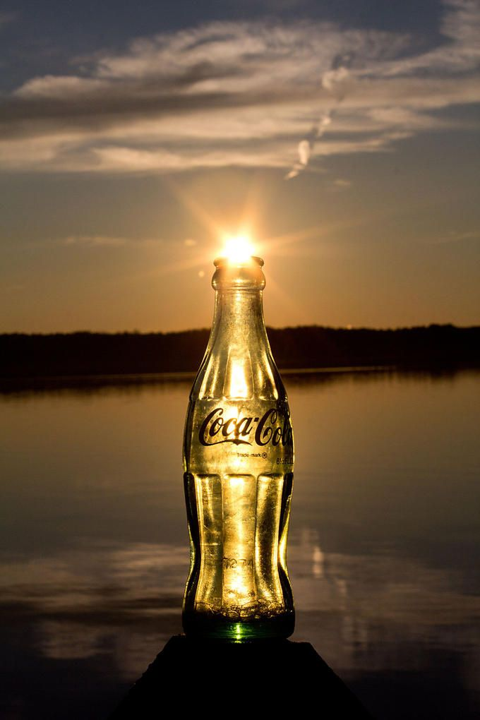 What a cool way to frame the sun! - Coca cola sunset