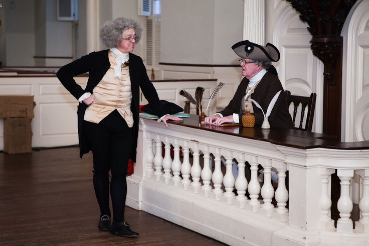 Meeting moderator Samuel Savage provides instruction to the Clerk - courtesy clerk