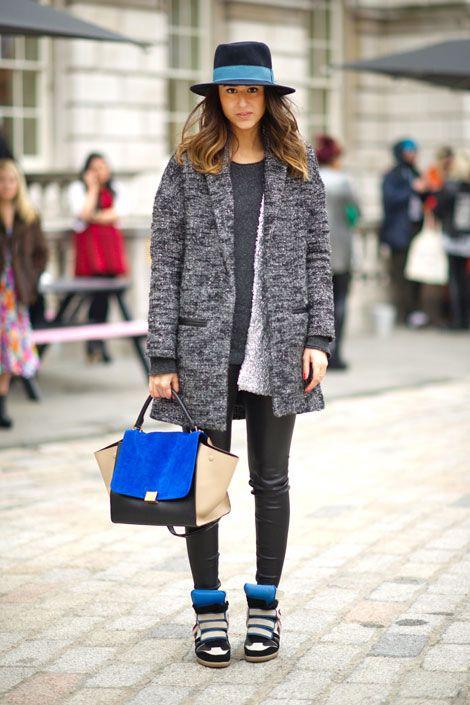 london. Soraya wears a Maje coat, Alexander Wang cardigan, Balenciaga leather leggings, Zara hat, Céline bag, and Isabel Marant shoes.