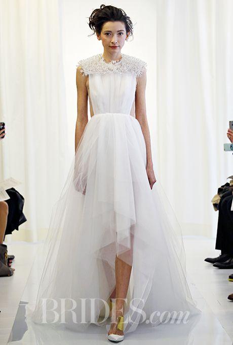 A textured, short-sleeved @angelsanchezpr wedding dress with a high-low hem | Brides.com