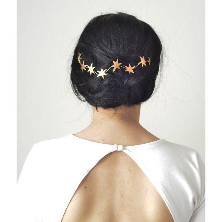 Accessoire pour sublimer sa coiffure de mariage : tiare d'etoiles dorées