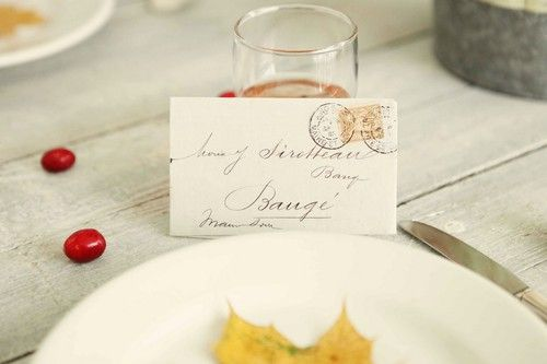 Inspiration: letter or mail placecards with vintage postage stamps and calligraphy.