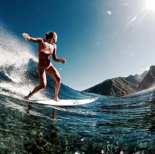Catching those waves in crystal clear water