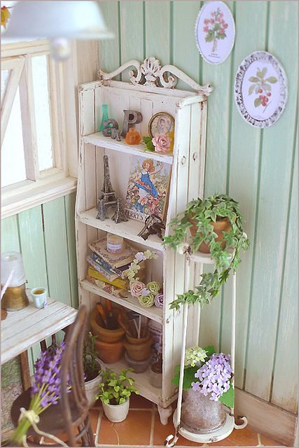 miniature shelf with lovely miniatures
