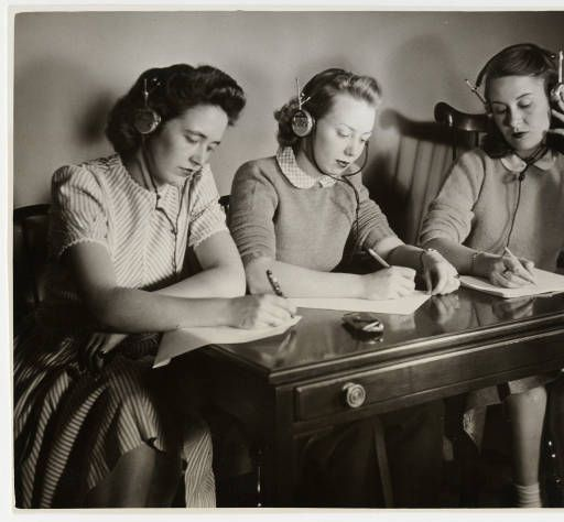 Three students from the Class of 1943 studying together, wearing headphones :: Archives and Special Collections Digital Images