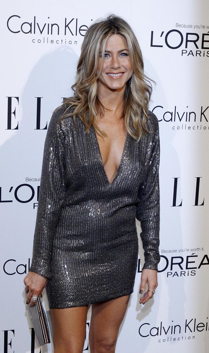 elle's Women in Hollywood Tribute, 2011  Playing up her sexy side, Aniston opted for a sequin KaufmanFranco dress (featuring a plunging neckline) along with a Ferragamo clutch.