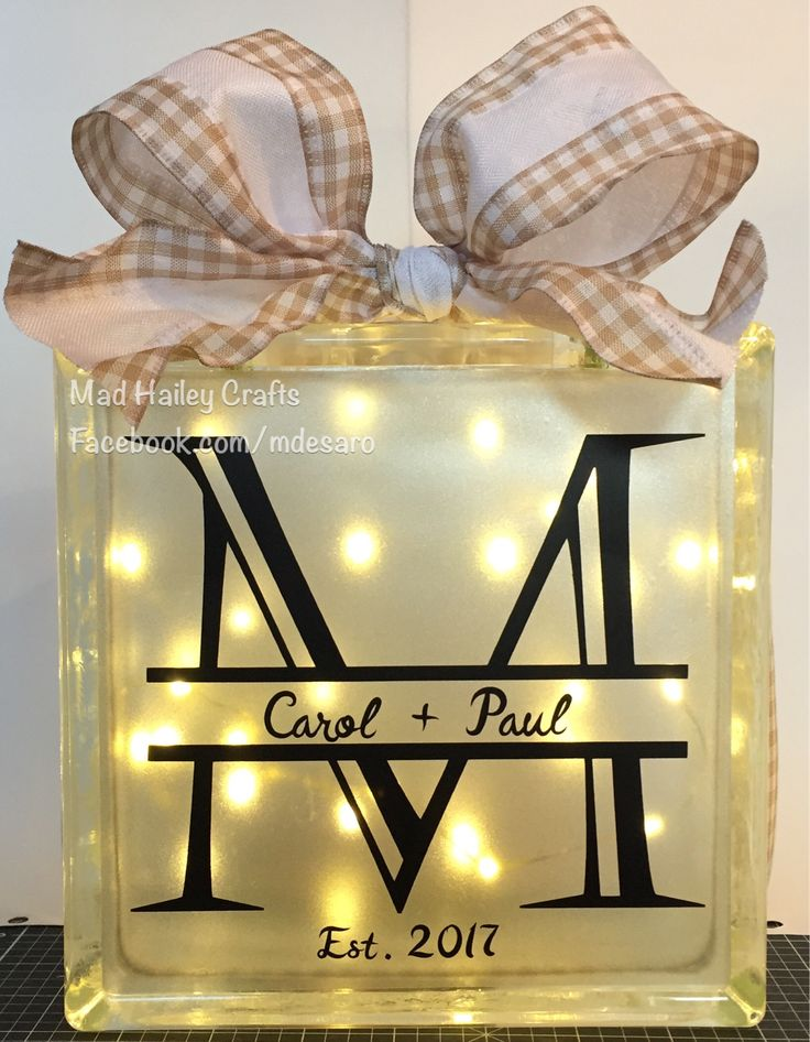 Lighted glass block.  Created the split monogram in Cricut Design Space using the Castellar font.  The names and est. 2017 are using the brush script font.  This was cut from Expressions Vinyl black vinyl and the frosting on the block is etched glass vinyl.  The ribbon was from Michaels.