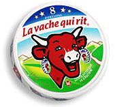 High contrast red cow with white horns against a lighter value of green and blue makes it stand out. cow has laughing cow wheels as earrings!!