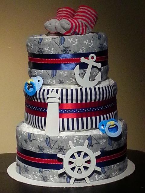 A fun diaper cake with a coastal marine theme