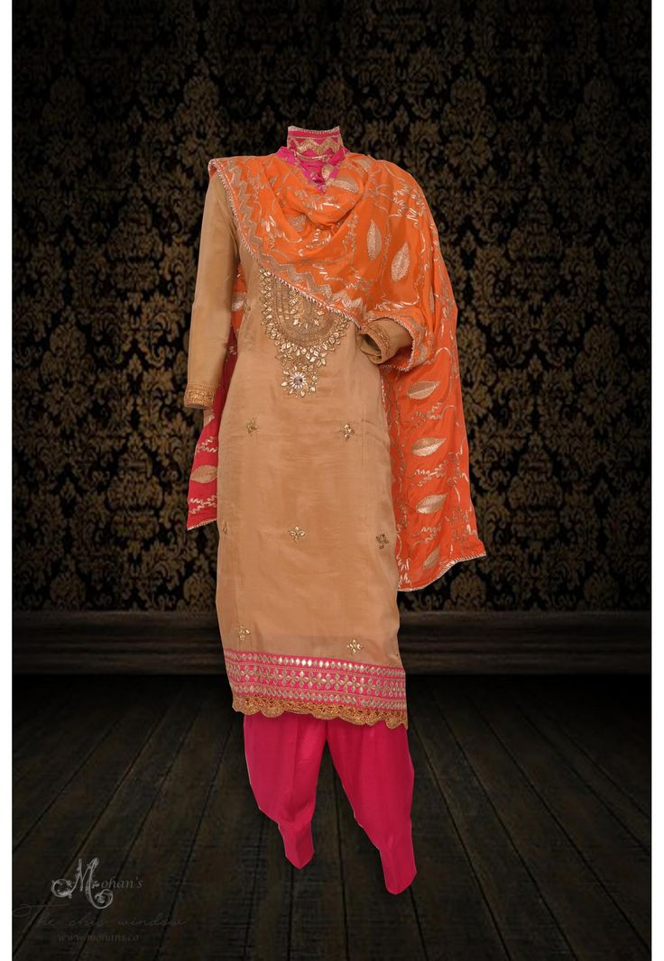 Gorgeous gold suit adorn in rich gota work