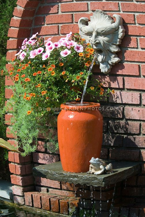 Garden Fountain Water And Ornament On Brick Wall With