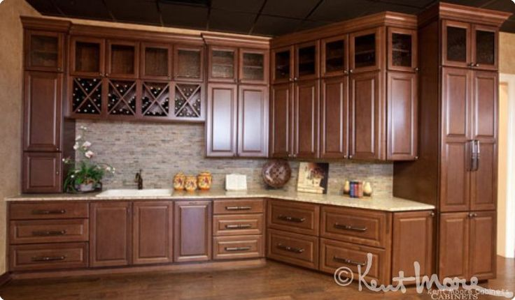 Kitchen Cabinets by Kent Moore Cabinets Dark Maple Wood with Burnt