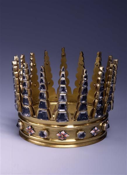 A Crown, from Saxony. 3rd quater 17th century. Gilded brass, rock crystal, and painted enamel. May have been an elaborate piece of costume jewellery. At the Staatliche Kunstsammlungen Dresden.