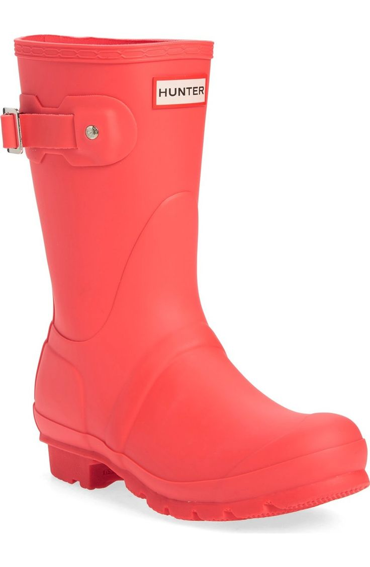 Swooning over these short Hunter rain boots in a bright pop of coral that are perfect for staying dry.
