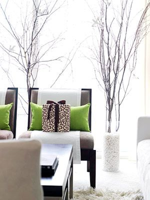 white rocks that look like snow in clear vases with large branches - LOVE!